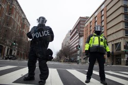 Police block off protesters at the intersection of 12th and K street in Washington D.C. Photo by Vaishnavee Sharma/BU News Service.