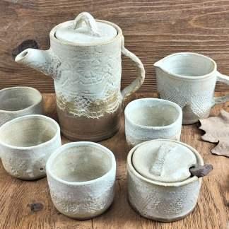 Juego de té o café con textura suave