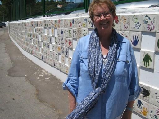 Saara at the wall of hands