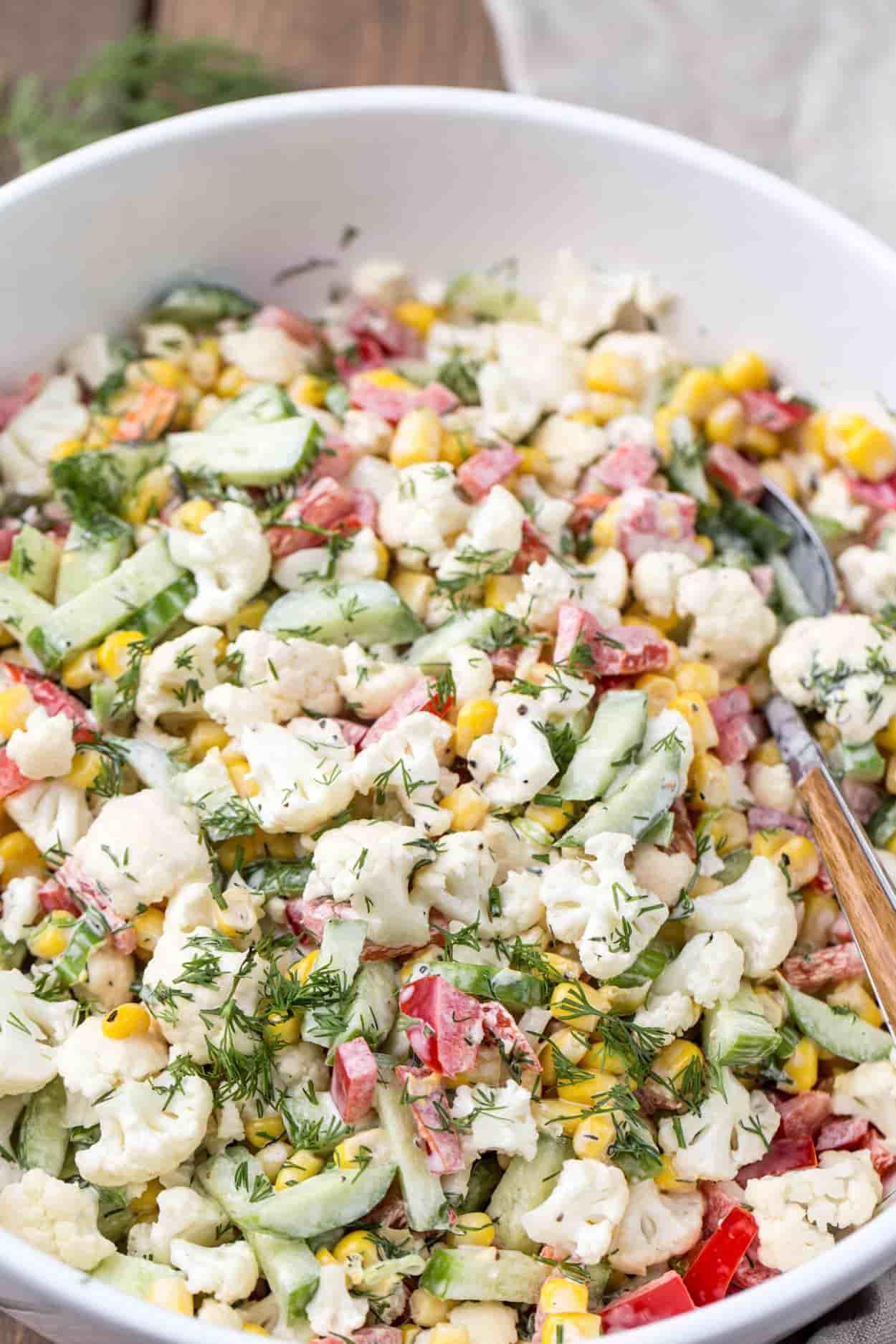 Cauliflower cucumber corn salad recipe in a bowl.