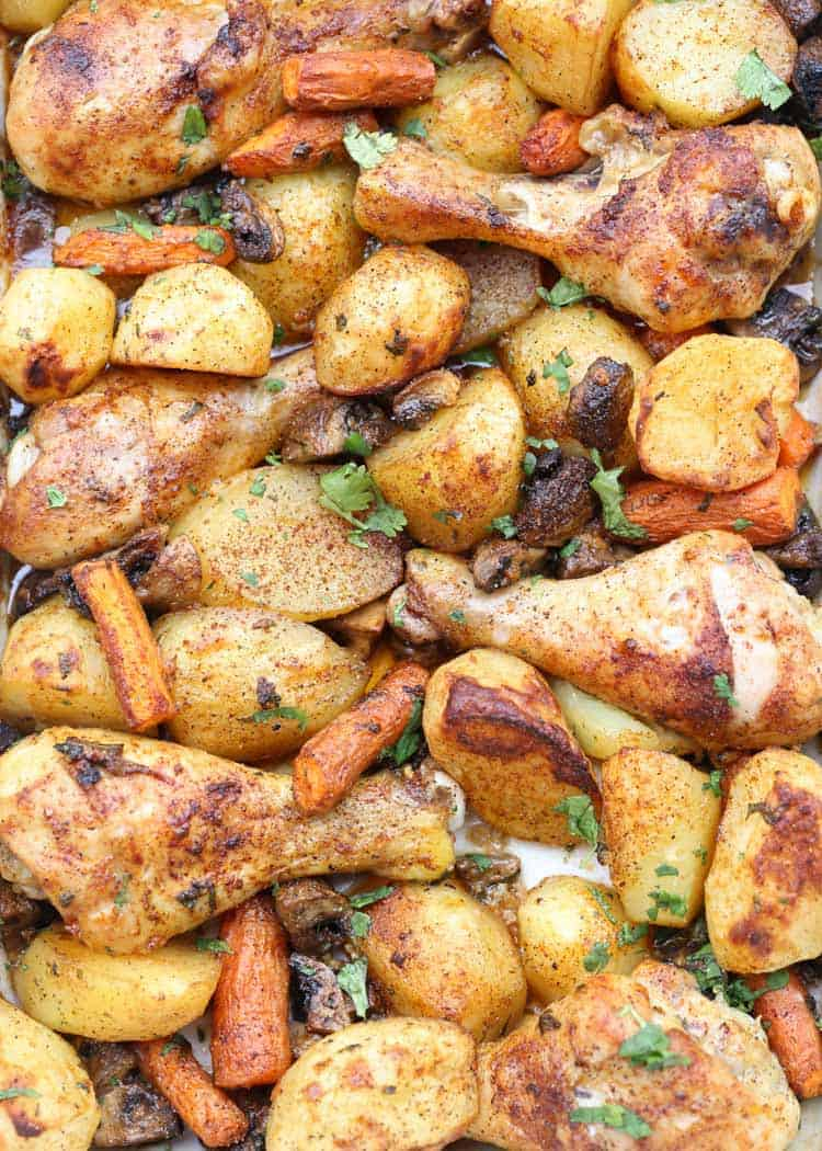 One Pan baked chicken drumsticks, potatoes and vegetables recipe.
