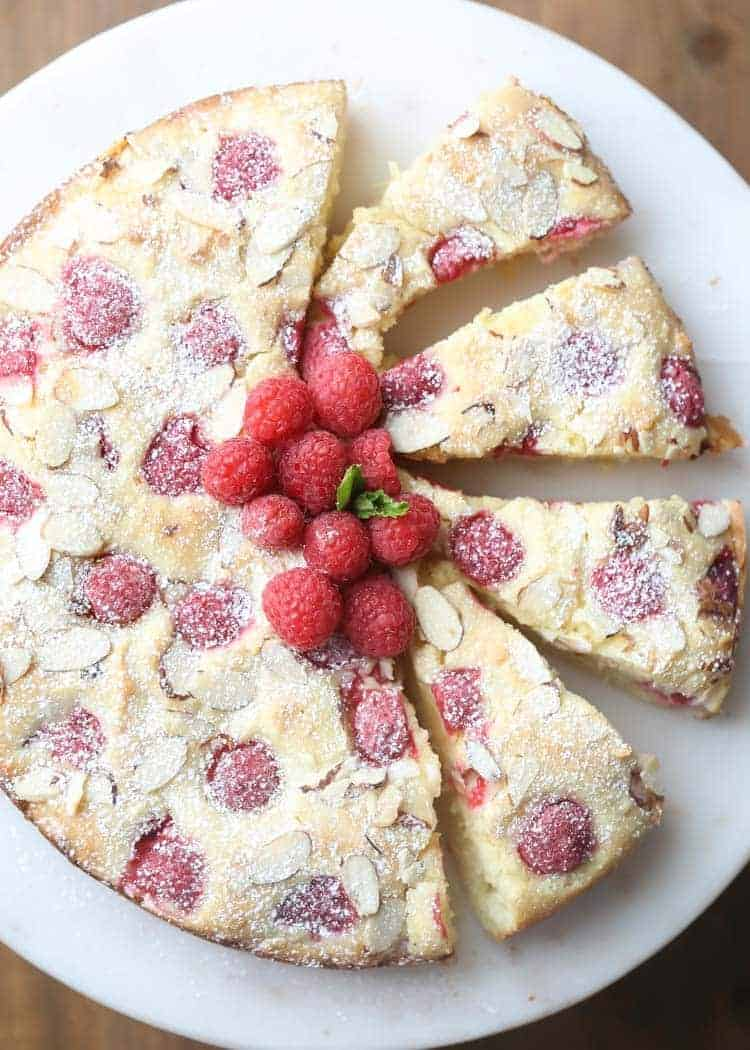 Sliced Almond Raspberry Coffee Cake on a Cake Platter.