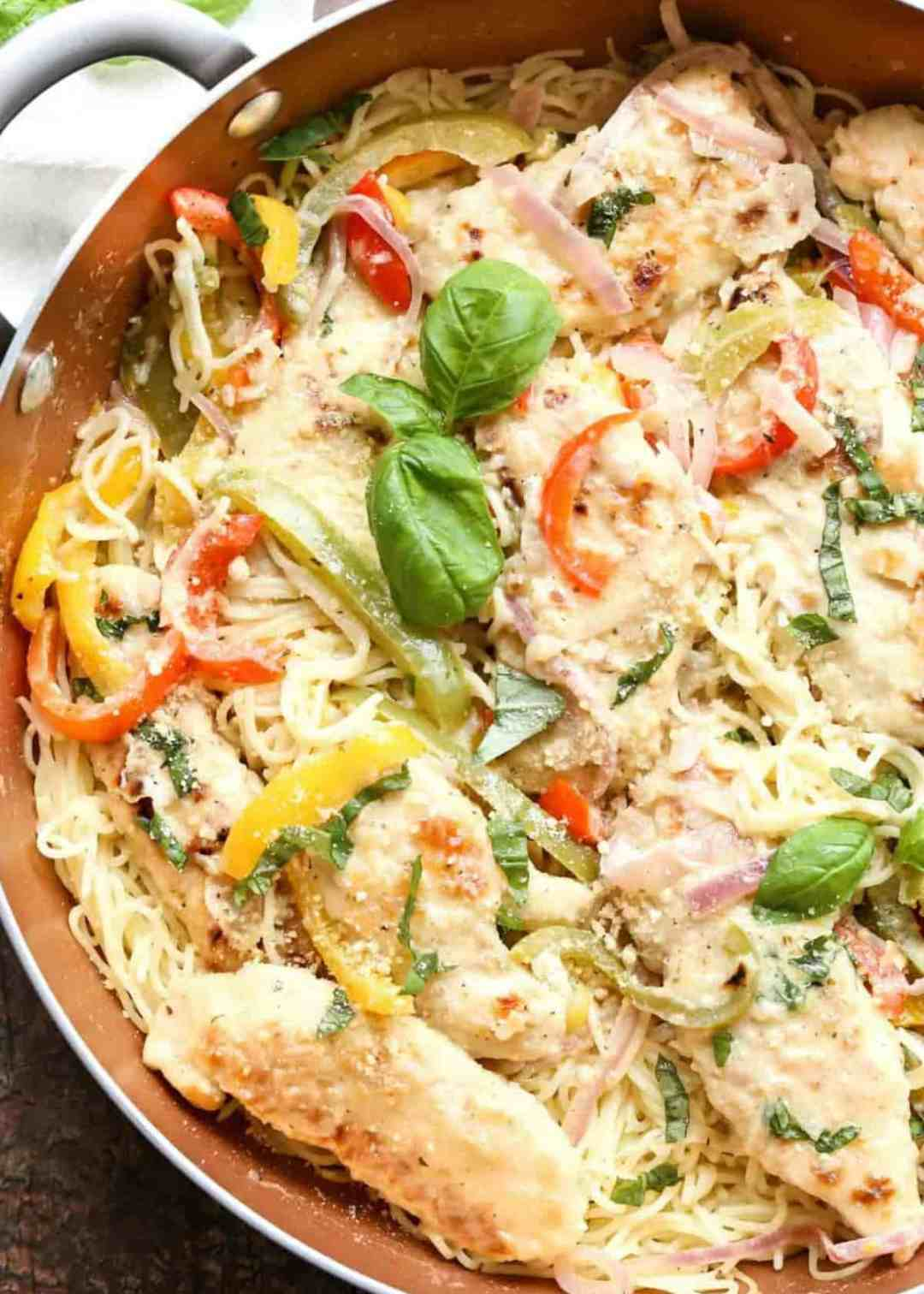 Chicken scampi recipe, sprinkled with parmesan cheese, in skillet.