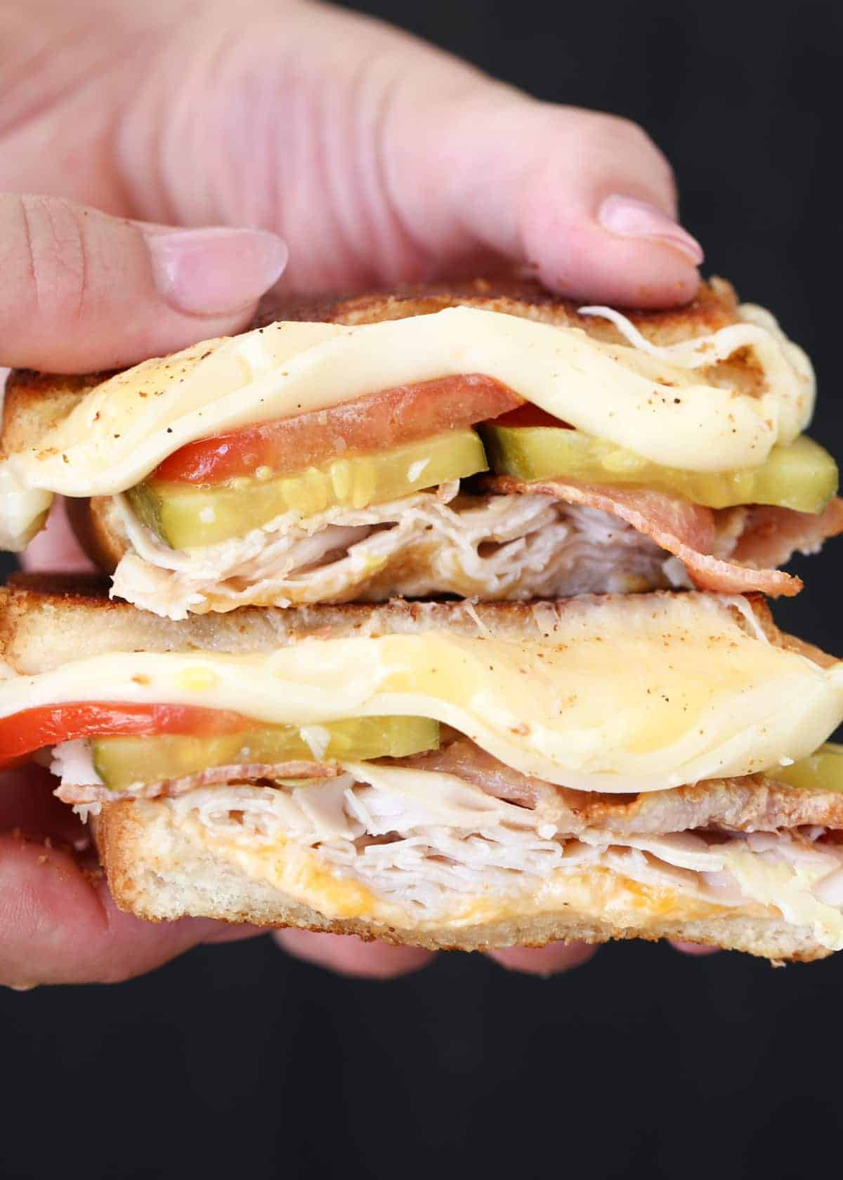 Turkey bacon grilled cheese recipe with tomatoes, pickles, and cheese.