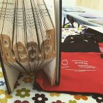 Book carved into Read sign - Nebraska State Literacy table