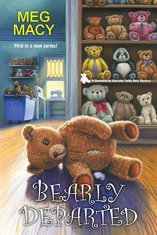 Book Cover: Bearly Departed by Meg Macy - teddy bear store/workroom setting - shelves full of teddy bears in the background and a partially unstuffed bear in the foreground on the floor.