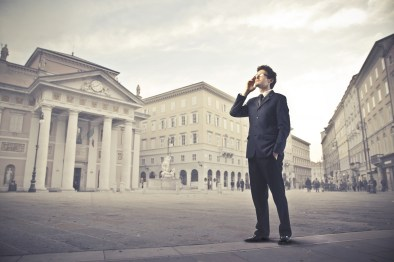A man thinking in a busy city.