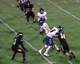 Connor Taber with the block. Joseph Slomer eyes Baxter