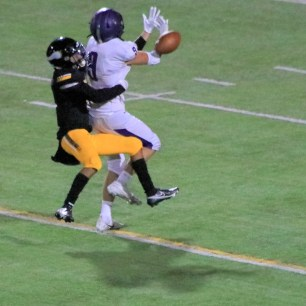 Ioseph Flores breaks up the pass to Nolan Mathers