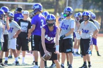 Jack Fridell takes the snap at Kang Football practice.