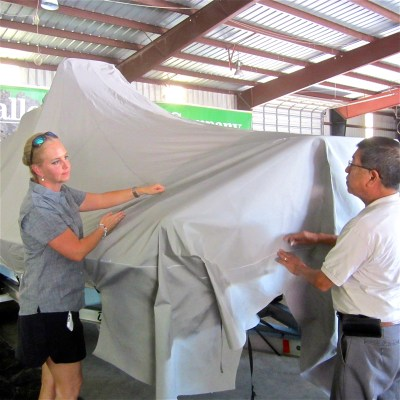 Hilco general manager Laurie Tresch confirms a boat cover pattern with long-time employee Manuel Lugo.