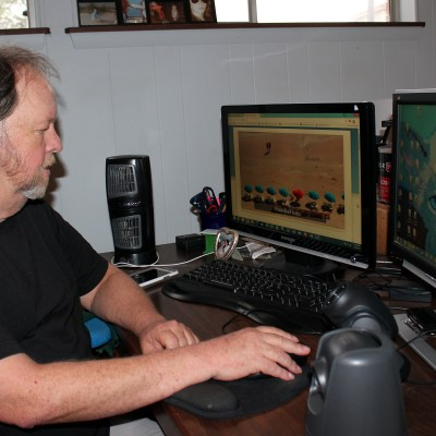 Jerry Wilson updates a Facebook page from his home office. (VBR)