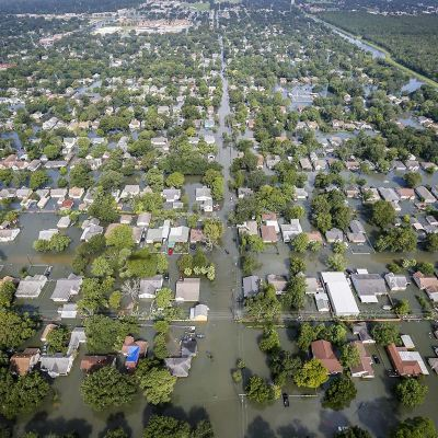 An aerial view shows extensive flooding from Harvey in a residential area in Southeast Texas on Aug. 31. (photo by Staff Sgt. Daniel J. Martinez, Air National Guard)