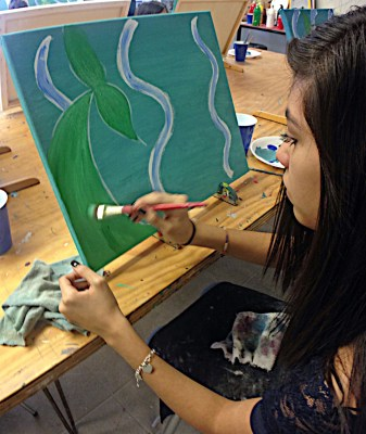 Art student Clarisa Benavides works on a painting during class. (VBR)
