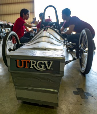 The Harlingen High School electric car team prepares for the competition with their coach. (Courtesy)