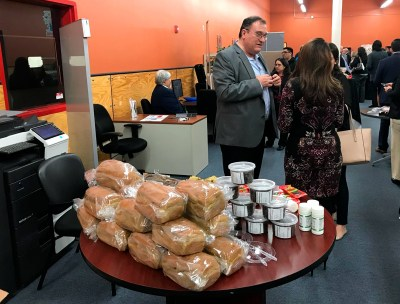 Mexican businessman Jose A. Garza Lopez shows his nopal-based products at an event at the center. (Courtesy)