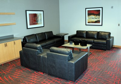 Private luxury boxes high above the arena floor are appointed with comfortable furniture. (VBR)
