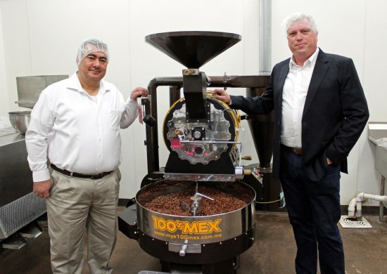 Mozna Chocolate owners Anthony Matulewicz (right) and partner Hassan Mulla stand next to a cocoa bean roaster. (VBR)