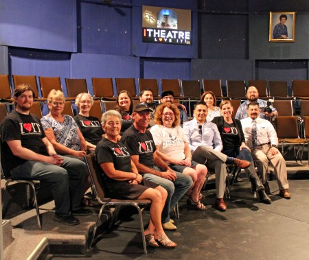 Steve Urbina (third from left in front) and his wife Kara (second from left) lead a group of volunteers in producing plays in the historic Tower Theater. (VBR)