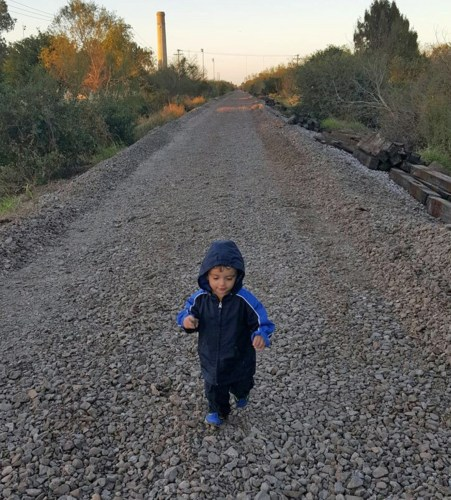 A toddler scampers along the Brownsville West Rail Trail, which is still under construction. (Courtesy)
