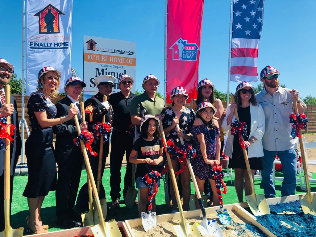 Representatives of the businesses and organizations that helped fund the home's construction take part in the groundbreaking. (Oskar Hernandez)
