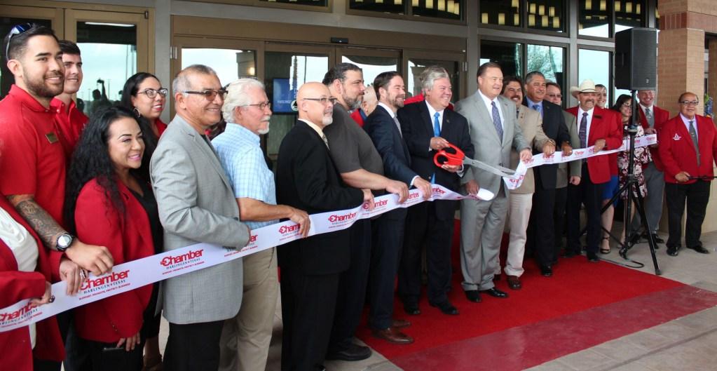 Harlingen Mayor Chris Boswell cut the ribbon to officially open the Harlingen Convention Center. (VBR)
