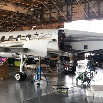 Scene at Harlingen airport hangar where TIA does repair and maintenance work on turbo engine jets.