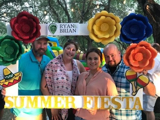 """The Ryan & Brian Teams """"Raving Fans"""" enjoyed a photo op at the Summer Fiesta customer appreciation event."""