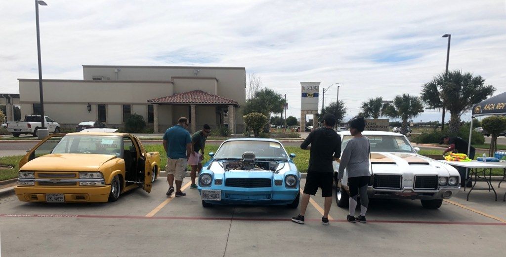 Visitors admire a classic muscle car.
