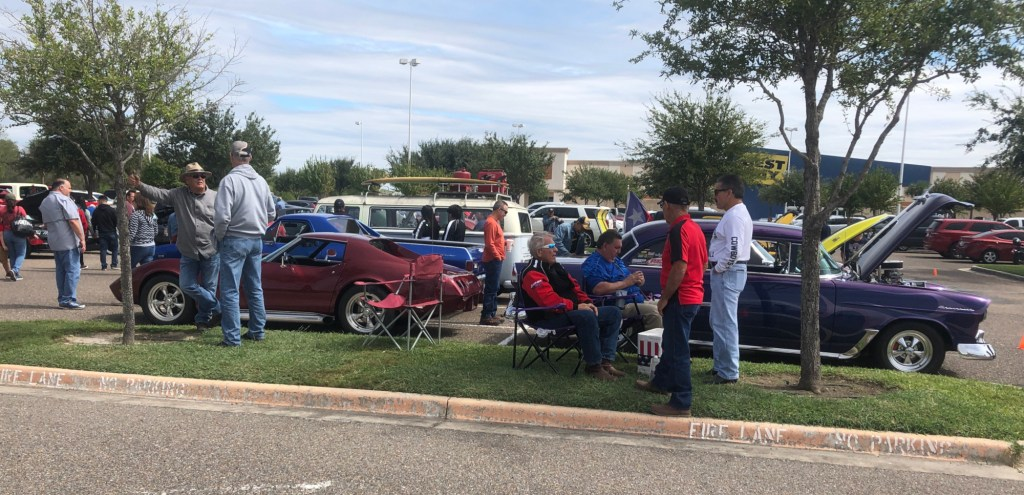Car owners talk shop with visitors about their cars.