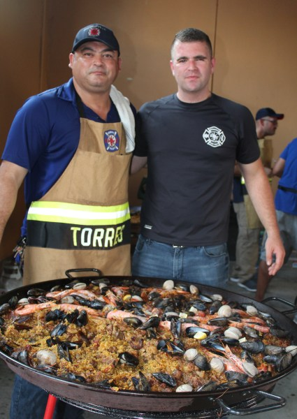 A meal like this one from two Brownsville firefighters will be the main dish at this Saturday's Paella for Prosperity in Brownsville.