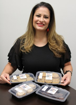Lisa Pulido, owner of Love at First Bite, a keto-friendly home bakery, displays a few of the sweet treats she offers.