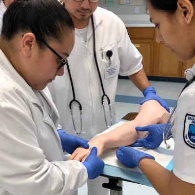 Vocational nursing students at Valley Grande Institute do skills practice in a lab.