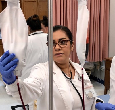 A vocational nursing student at Valley Grande Institute focuses during skills practice.