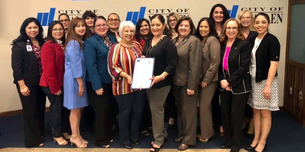 Female City of McAllen employees in 2019 with a city proclamation marking Women's History Month.