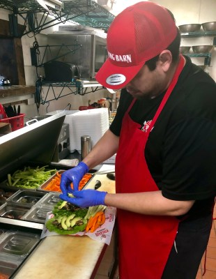 A cook prepares an order at the Harlingen location.