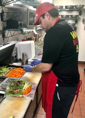 A cook at work at Wing Barn, which was offering 50-cent wings while shelter-in-place orders are in place.