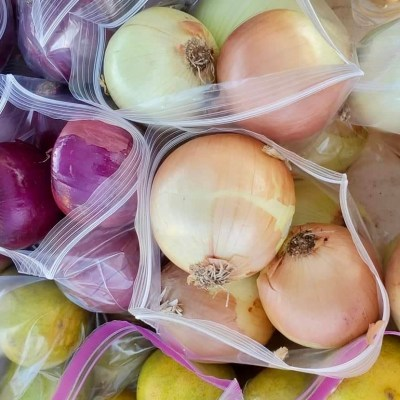 Onions, vegetables and fruits are bagged for pickup and delivery from Rancho Viejo Farmers Market. (Courtesy)