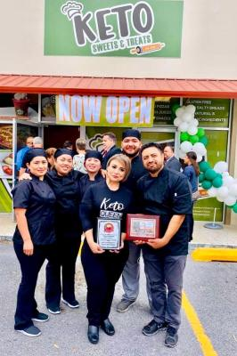 Karla Ugarte and Juan Palma, center, with their employees at the opening of their McAllen bakery in early March 2020. (Courtesy)