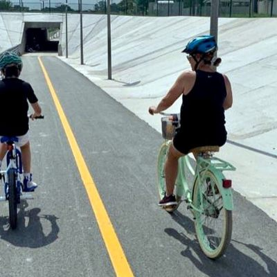 Cyclists ride toward one of four underground tunnels of the Precinct 2 trail. (Courtesy)