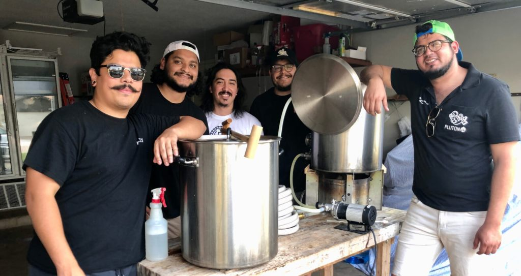 Danny Arizpe, right, and Joey Martinez, center, are the leaders a band of buddies in forming Pluton Brewery.