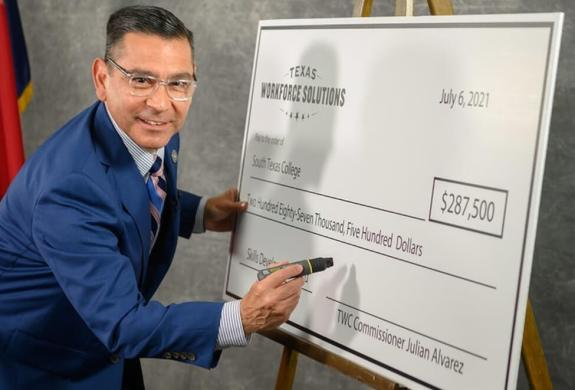 Texas Workforce Commissioner Representing Labor Julian Alvarez III presents South Texas College with a Skills Development Fund grant to keep local, regional and state economies moving forward.
