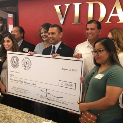 TWC Commissioner Julian Alvarez, center, awards VIDA and its students a $350,000 state grant.