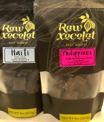 Packages of chocolate sourced from around the world are at Raw Xocolat.