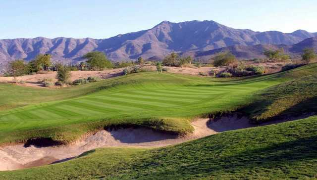 The Aquila Golf Course facility offers two golf courses; one is a Championship length course while the other is a par-3, nine-hole course. The championship course provides an excellent game of golf for an affordable price. There are scenic views of mountains and downtown Phoenix as well as a challenging layout featuring several water hazards and bunkers. Although the terrain is rather hilly, it is still relatively walkable. The course has an excellent range of holes that each have a unique character, the par 5's are especially notable. Native grasses and wildflowers are also present on Aquila's Championship course, further adding to its natural beauty.