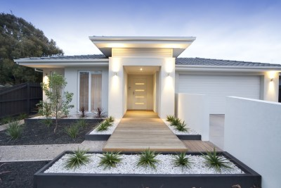 35973993 - facade and entry to a contemporary white rendered home in australia