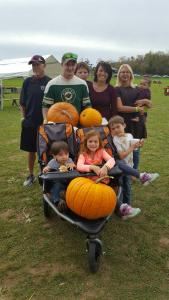 Family finding perfect pumpkins