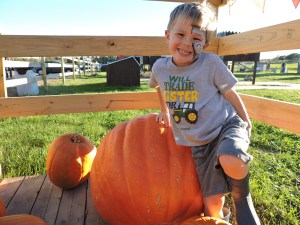 Boy with Large Pumpkin