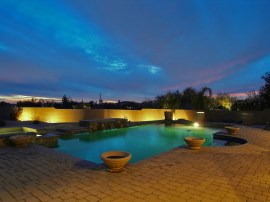 custom home pool at sunset