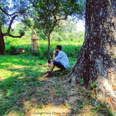 My son resting from the heat after hunting for ancestors grave in Meerut Cantonment Cemetery